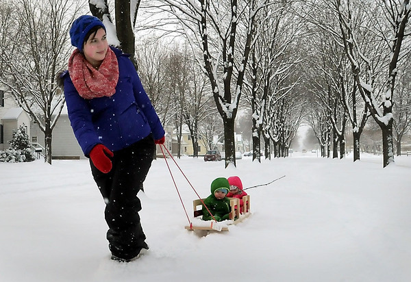 John Cross<br /> Megan O'Toole and daughters, Bell (front) and Blue, take a stroll down the boulevard on Broad Street during Friday's storm.