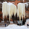 Pat Christman<br /> Ice hangs from the cliffside as visitors explore one of the many caves along the Lake Superior shoreline.