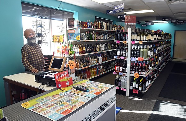 Tirlochn Mand in the family's liquor store, Madison Liquor. Photo by Pat Christman
