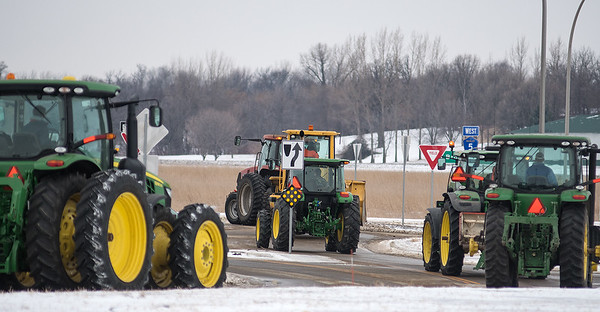 St. Peter high school students drive through a roundabout as they leave the parking lot of St. Peter High School at the end of the school day on Thursday. Eight students at St. Peter High School drove their tractor to school as part of National FFA Week. Photo by Jackson Forderer
