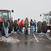 Members of St. Peter's Future Farmers of America gather around Ben Eide's 1945 John Deere B tractor in the St. Peter High School parking lot after classes were dismissed on Thursday. As part of National FFA Week, students drove their tractors to school. Lunch was also served students and teachers with food grown by FFA members. Photo by Jackson Forderer