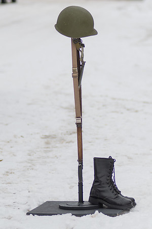 The battlefield cross for Victor Paradis in the snow outside of St. Joseph the Worker Catholic Church. Photo by Jackson Forderer