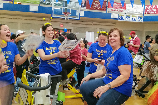 Ginny Scheurer pedals as part of the Mayo Clinic North Ridge team Saturday at the seventh annual Pedal Past Poverty fundraiser. Organizers estimate the event drew $75,000 towards housing for homeless and low-income resides in the area. Photo by Trey Mewes