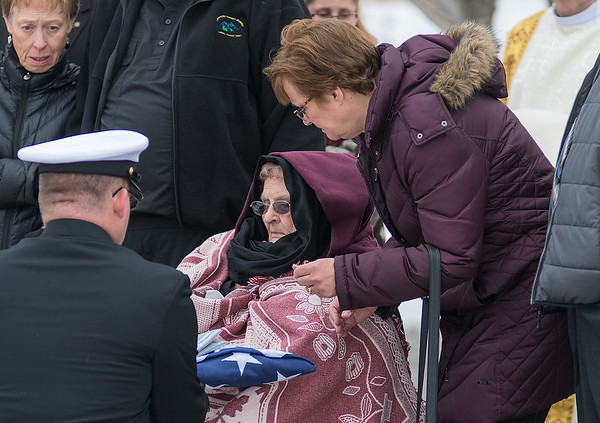 Jan Nelson (right) talks to her mother Lucille Paradis, 98, while Chief Chris Stauffer offers the gift of the American flag on behalf of the Armed Forces at Victor Paradis' funeral held on Saturday. Nelson would take the flag on behalf of her mother, who was married to Victor Paradis for 72 years. Photo by Jackson Forderer