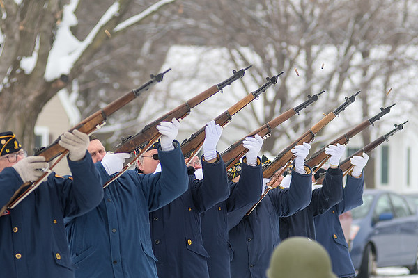 Shells fly as the Mankato Area Veterans Memorial Squad give a 21-gun salute as part of the military honors for Victor Paradis. Paradis was one of three Pearl Harbor survivors in Minnesota. Photo by Jackson Forderer
