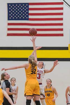 Lexi Karge (32) of Mankato East and Amanda Younge of Mankato West tip off the game on Friday evening at East. The East/West girls basketball game was held on Friday, with the East/West boys game played on Saturday, as the regular season winds down and playoffs begin. Photo by Jackson Forderer