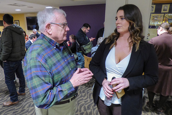 Southern Poverty Law Center Outreach Manager Kate Chance (right) talks with Bill Webster, a founder of the Minnesota State Uuniversity-based Kessel Peace Institute. Webster said he's been a supporter of the SPLC for 40 years. Photo by Dan Greenwood