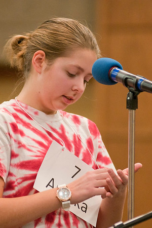 Annika Wheeler from Fairmont Elementary School writes a word out on her hand before spelling it at 2017 Regional Spelling Bee held at South Central College on Tuesday. Photo by Jackson Forderer