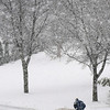 John Cross<br /> Dick Kunzia moves snow from his St. Peter driveway during Sunday's snowfall.