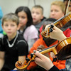 John Cross<br /> Third-graders from Mankato schools watch a demonstration of musical instruments as part of the Music Appreciation at the Elementary School Level program on Friday.