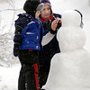 John Cross<br /> Dave Greisen of St. Peter and his son, Owen, put the finishing touches on the snowman they built with the heavy, wet snow that fell on Sunday.