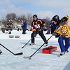 Pat Christman<br /> Pond hockey players battle it out near the goal during the Anthony Ford Pond Hockey tournament Saturday on Lake Washington.