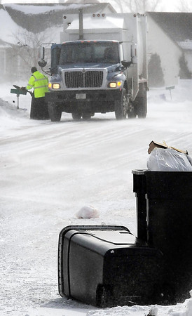 John Cross<br /> A Hansen Sanitation worker makes his rounds in Upper North Mankato on a windy Thursday.