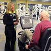 Pat Christman<br /> Instructor Chris Schull talks with one of the Livestrong class particpants during a workout.