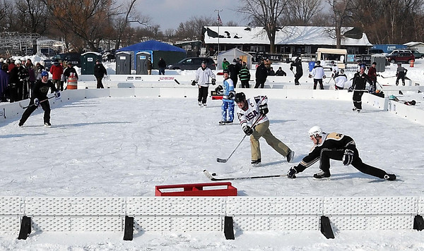 Pat Christman<br /> A pond hockey player deflects away a potential goal during a game Saturday.