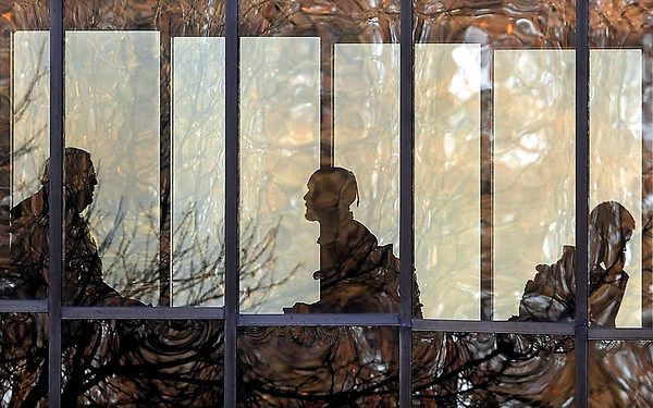 John Cross<br /> Students and faculty at Minnesota State University are caught in a swirl of reflections in a glass walkway as they head to class for the beginning  of the spring semester on Monday.