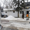 John Cross<br /> Fire crews pick up gear after battling a structure blaze in St. Clair on Wednesday.