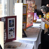 Pat Christman<br /> A Lions Club member looks at displays during the club's Mid-Winter Convention Saturday at the City Center Hotel.