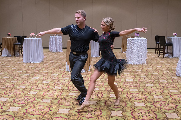 Dr. Colin Weerts (left) and his dance partner Allie Wilson practice their Latin-themed dance in the Verizon Center before taking the stage at Dancing with the Mankato Stars  on Saturday. Weerts and Wilson won the judges choice award for their performance. Photo by Jackson Forderer