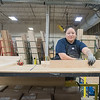 Hope Badten sorts through different pieces of wood at the Elkay Wood Products plant in New Ulm. Photo by Jackson Forderer
