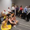 Contestants in the Dancing with the Mankato Stars hang out in the green room backstage and watch other performers on a television in the room. Photo by Jackson Forderer