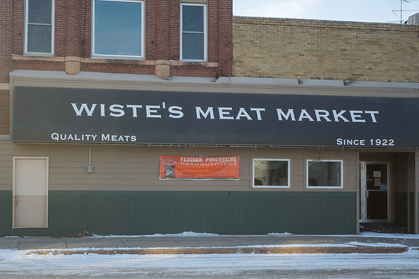 The exterior of Wiste's Meat Market in downtown Janesville. The business is closed until further notice after a fire destroyed a neighboring business. Photo by Jackson Forderer