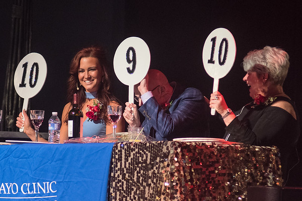 Jonathon Zierdt (center) hides his face from a booing audience after giving one of the duos in Dancing with the Mankato Stars a score of nine. The other judges included Bridget Carlson (left), a Minnesota Vikings cheerleader and dance choreographer and Sarah Richards (right), President and CEO of Jones Metal Inc. Photo by Jackson Forderer