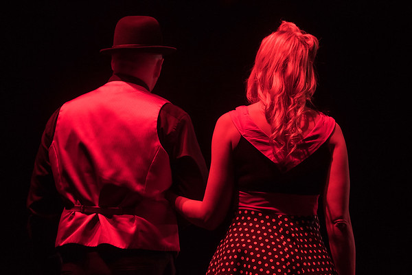 Ben Hoffman (left) and Shannon Beal wait to start their Charleston-style dance as the lights slowly came up at the Verizon Performance Center during Dancing with the Mankato Stars. Photo by Jackson Forderer