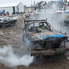 Brandon Bowe (center) gets his car moving in reverse during the full size division at the Winter Slam Demolition Derby held at the Nicollet County Fairground in St. Peter on Saturday. Four different divisions were held at the demo derby in its ninth year. Photo by Jackson Forderer