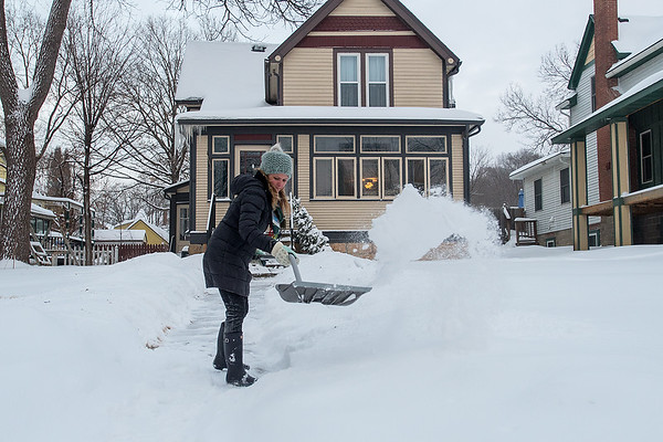 Amber Massaglia Fitzsimmons shovels the walk to her house in Mankato on Thursday. Photo by Jackson Forderer