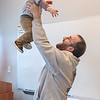 Aaron Sorenson hoists his son Lane, 15 months, into the air at the Children's Museum of Southern Minnesota at the end of a program for new moms and moms-to-be sponsored by the museum and the Mayo Clinic. Photo by Jackson Forderer