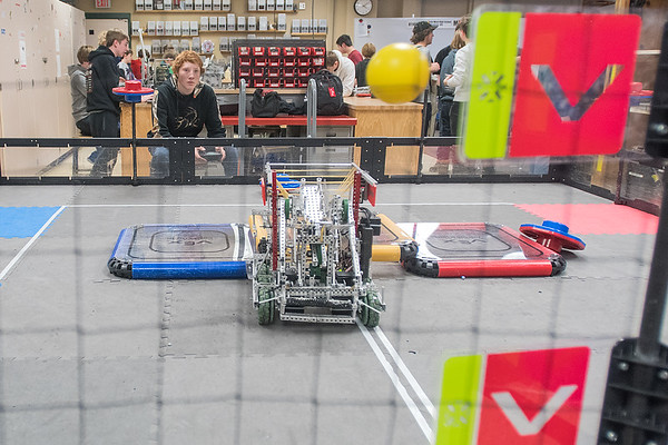 Mitchell Robertson (upper left), 17, uses the Vex Robotic to fling a ball at a target at Mankato West High School on Tuesday. Photo by Jackson Forderer