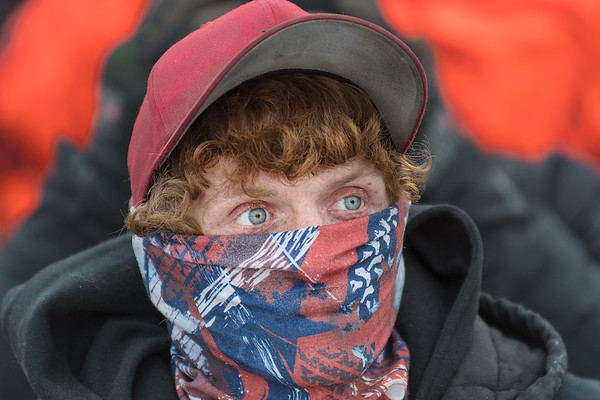 Scott Dille from Wisconsin watches the Winter Slam Demolition Derby from the grandstands at the Nicollet County Fairgrounds in St. Peter on Saturday. Dille and his friends traveled from Wisconsin to cheer on their friends and compete in the demolition derby. Photo by Jackson Forderer