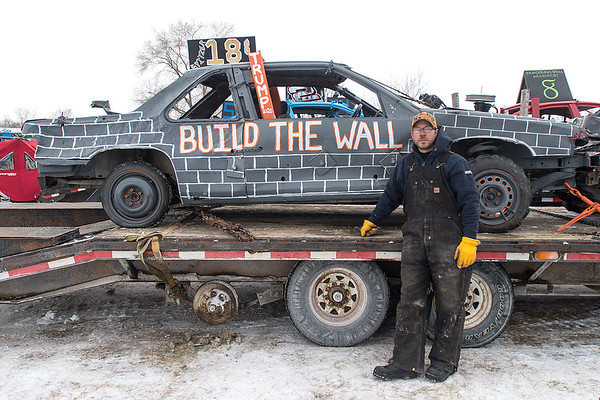 """Andrew Spitzer from Dover, Minn. makes a political statement with his Trump """"Build the Wall"""" car at the Winter Slam Demolition Derby held on Saturday in St. Peter. Spitzer said about competing in the compact class, """"I didn't do so well, the axel snapped right away so what are you gonna do. I had fun."""" Photo by Jackson Forderer"""