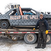 "Andrew Spitzer from Dover, Minn. makes a political statement with his Trump ""Build the Wall"" car at the Winter Slam Demolition Derby held on Saturday in St. Peter. Spitzer said about competing in the compact class, ""I didn't do so well, the axel snapped right away so what are you gonna do. I had fun."" Photo by Jackson Forderer"