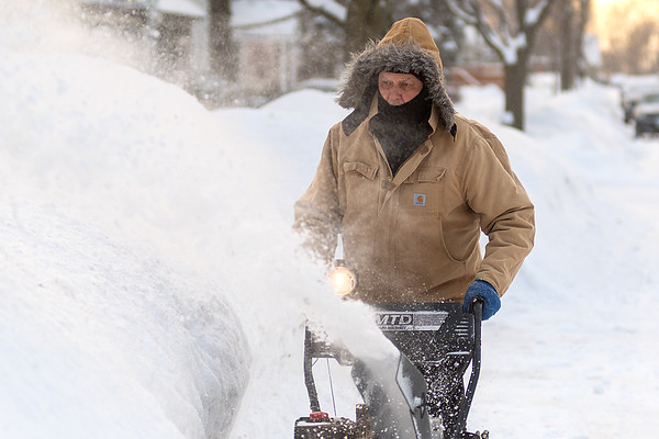 Jim Adam blows snow in front of his house on West Lewis Street in Mankato on Thursday. Photo by Jackson Forderer