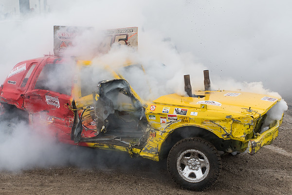 Steve Rowan of Elk Mound, Wis. drives out of the corner of the demolition derby track after being boxed in by another driver in the 80's Chain division. Rowan would later vent his frustration at the other driver by throwing his helmet at their car. Photo by Jackson Forderer