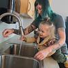 Angela Schafer helps her son Baker Schafer Daum, 18 months, wash his hands after Baker showed interest in the sink in the Rotary Room at the Children's Museum of Southern Minnesota following a support group for new moms and moms-to-be. Photo by Jackson Forderer