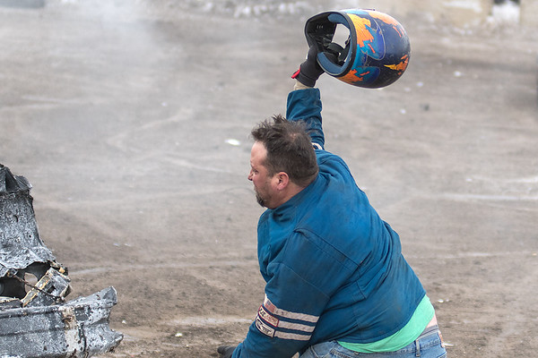 In a heated moment, Steve Rowan from Elk Mound, Wis. throws his helmet at another car in the Winter Slam Demolition Derby. Rowan was upset after being boxed into a corner during the 80s chain division demo derby. Photo by Jackson Forderer