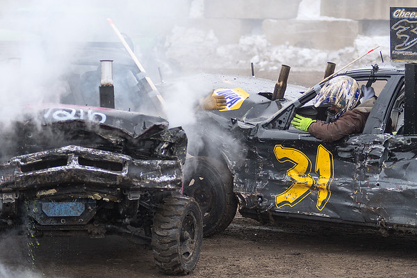 Dan Marrs from Booneville, Mo. reaches his hand out to congratulate Joey LaGrander (right) from Stanley, Wis. for winning the 80's Chain division at the Winter Slam Demolition Derby. Photo by Jackson Forderer