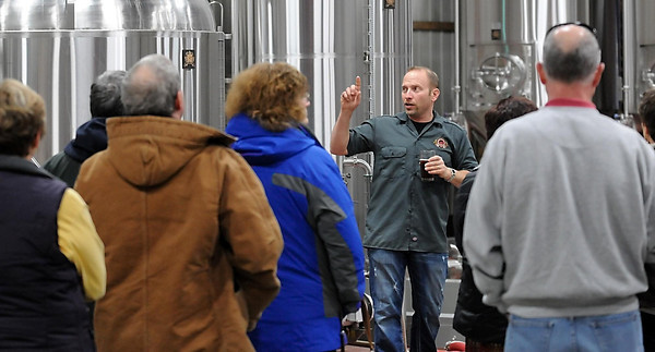 Mankato Brewery co-founder Tim Tupy gives a tour during the brewery's first anniversary celebration Saturday.