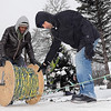 John Cross<br /> Minnesota State University students Wendiinko Ouedraogo (left) and Omar Chaudhry roll of  a spool of LED lights during the removal of the Kiwanis Holiday lights display on Tuesday.