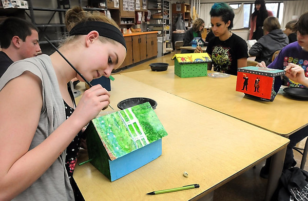 Mankato West art student Emma Henry finishes up her Monet-inspired bird house roof Thursday. The students spent two weeks painting bird houses that will be auctioned off in April to benefit Habitat for Humanity.
