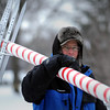 John Cross<br /> Brian Fowler carries away sign post during the removal of the Kiwanis Holiday Lights display at Sibley Park on Tuesday.