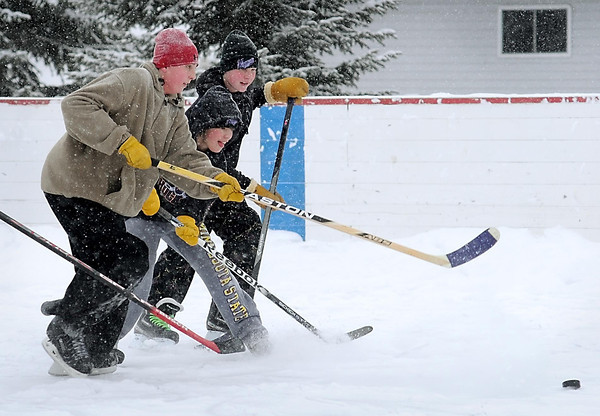 John Cross<br /> Youngsters play some pick-up hockey at the skating rink in Eagle Lake.