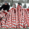 "John Cross<br /> ""Pinky Bruiser"" (left) and ""Reignbow Sparkles"", members of the Mankato Area Derby Girls, bring some of the hundreds of candy canes that were part of the Kiawanis Holiday Lights display to a trailer during tear-down activities last week."