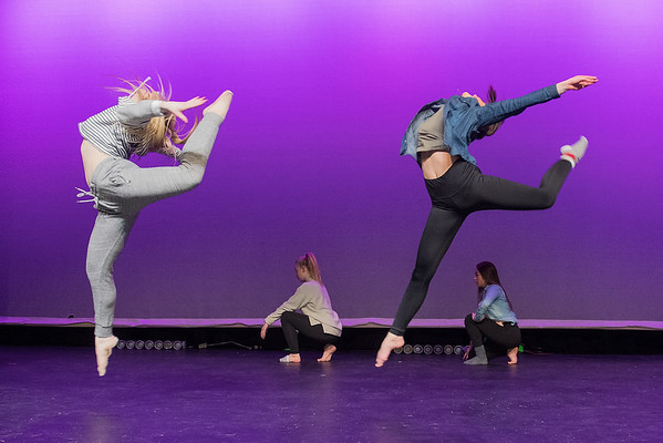 Carly Roering (right) and Rylie Rosenfeld jump during a dance rehearsal at Mankato West. Photo by Jackson Forderer