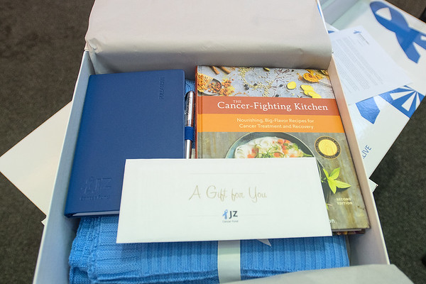 The Jonathan Zierdt Cancer Fund care packages delivered to Mayo Clinic Health Systems includes a cancer-fighting cookbook, a blanket, an empty pad for journaling and a gift card. Photo by Jackson Forderer