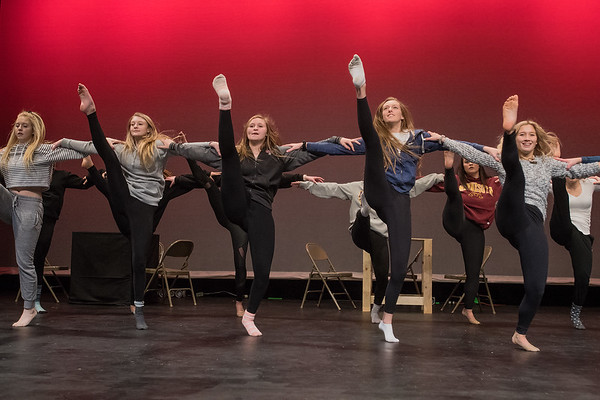 Dancers from Mankato West line up and kick at a rehearsal for their upcoming performance. Photo by Jackson Forderer