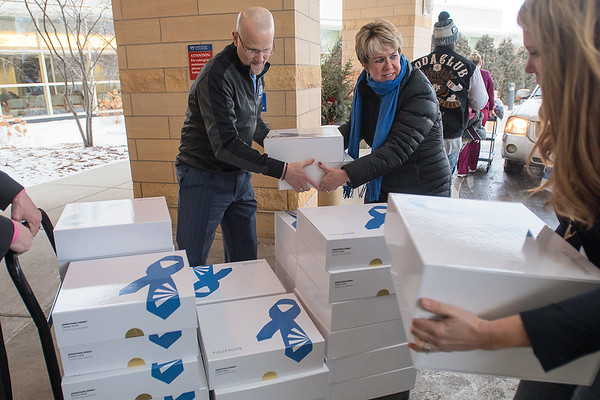 From left, Jonathan Zierdt, Tami Paulsen and Laura Boman load care packages onto a cart outside of Mayo Clinic Health Systems on Thursday. The care packages were donated by the Jonathan Zierdt Cancer Fund and will be delivered to patients that have been diagnosed with cancer. Photo by Jackson Forderer